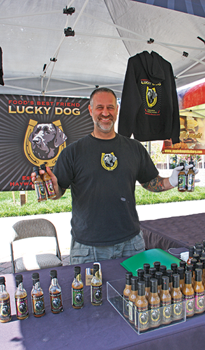 Scott Zalkind hawks his hot sauce at the Hayward Farmers' Market on Saturdays.