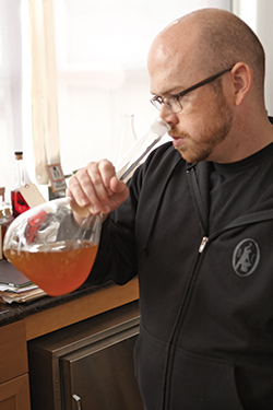 Dave Smith, distiller and blender at St. George Spirits, evaluates his work in the laboratory.
