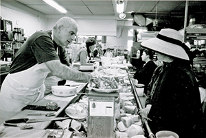 A busy day in the mid 1990s at Berkeley's Cheeseboard Collective (Photo courtesy of the Cheeseboard Collective)