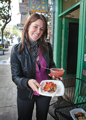 Edible Excursions founder Lisa Rogovin tastes the black bean polenta at Berkeley's Juice Bar Collective. (Photo courtesy of Edible Excursions)