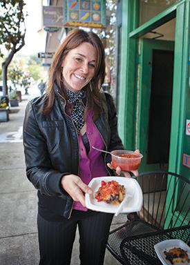 Edible Excursions founder Lisa Rogovin tastes the black bean polenta at Berkeley's Juice Bar Collective. (Photo courtesy of Edible Excursions)