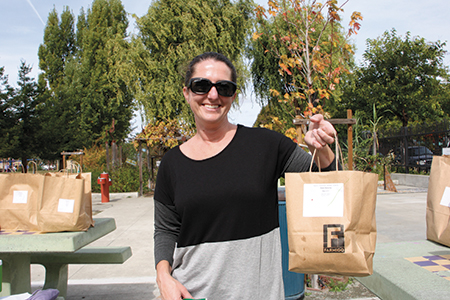 Every Wednesday at Malcolm X Elementary in Berkeley, parent Rebecca Matthews helps distribute produce, meat, and dairy items purchased through Farmigo.com.