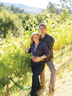 Paul Coletta and Katie Kaiser tend the vines at Coletta's original Humblebee Farm vineyard, which sits in the favorable microclimate of the Orinda Eye.