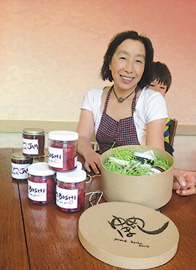 Ayako Iino (that's her young son Kai peeking out from behind) with jars of her umeboshi, aka umesu vinegar, and deliciously sweet ume-peach preserve.