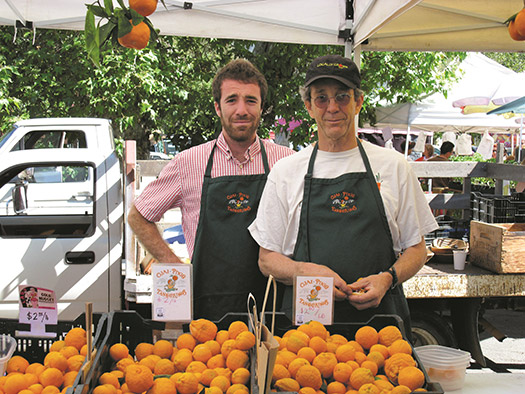 im Churchill (above on right) sell their citrus and avocados at the Berkeley Farmers' Market with help from Willie Walsh.