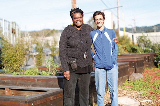 Joy Moore (left), gardening and cooking instructor at the Berkeley Independent School takes, a break in the day to give a garden tour with student Sami Mirza, the writer of this story.