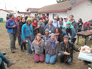 Students from the Merritt College mushroom class gather at Far West Fungi's 2013 farm tour and potluck barbeque in Moss Landing.  Professor Ken Litchfield is in the middle (bearded, with brown cap).