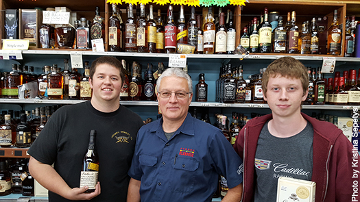 Ed Ledger gets help in the shop from his sons Nick (left) and Austin.