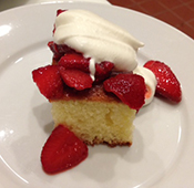 Olive oil cake, served here with strawberries and cream rather than citrus. It's delicious either way.   Photo courtesy of Benchmark Pizzeria.