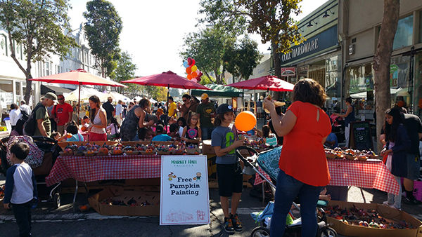 Rockridge locals and visitors celebrate the neighborhood with food, music, circus arts, and pumpkins.