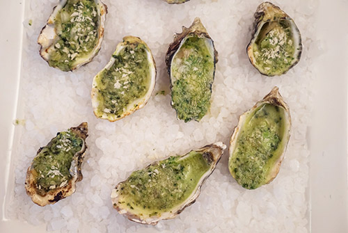 Oysters Rockefeller is a classic favorite with many variations. Photo courtesy of Jon Orlin.