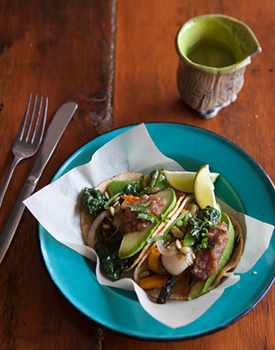 Nido serves Mexican favorites, such as tacos, tostadas, and quesadillas, with a fresh twist. Pictured: The veggie taco with pepitas, avocado, and casera salsa
