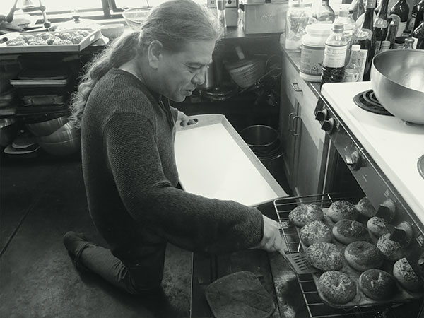 Chef Phil Gelb makes bagels for one of his music/dinner events in his West Oakland kitchen. Photo by Rebecca Martinez
