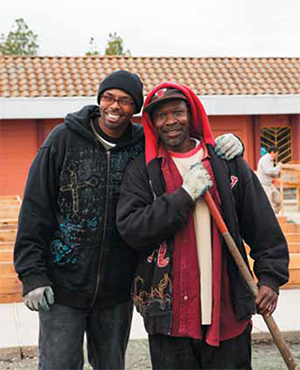 Kevin Williams (left) and Julius Jones were hired by Planting Justice after taking part in the San Quentin Insight Garden Program. Williams was recently promoted from landscaper to trainer. (Photo by Stacy Ventura)