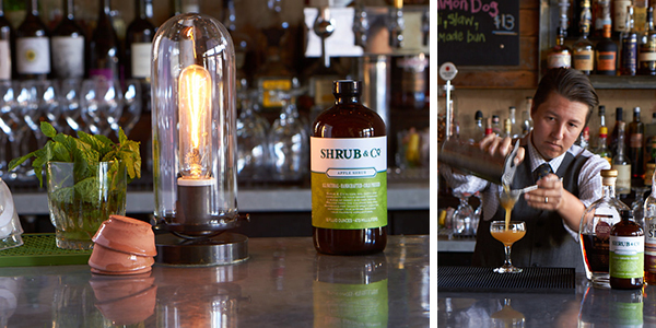 Nat Harry strains a Sin Eater into the glass at Revival Bar + Kitchen.