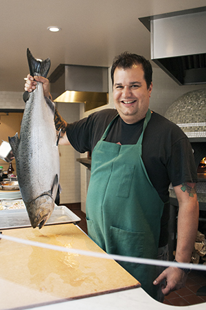 Rocky Maselli, executive chef at A16 Rockridge, with a California king salmon. Maselli gets his seafood from TwoXSea, a Sausalito-based seafood purveyor that prides itself on its exemplary sourcing practices.   (Photo by Stacy Ventura)