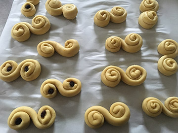 Santa Lucia buns are sometimes adorned with currants or raisins and often served with coffee. Photo: Kelly Chappie