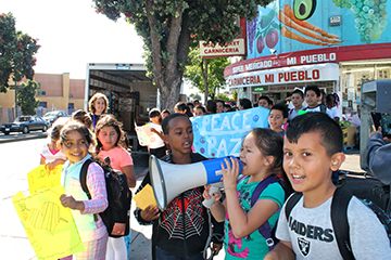 Sunday Suppers beneficiary Oakland Leaf hosts an end-of-year student showcase, community celebration, and peace march.