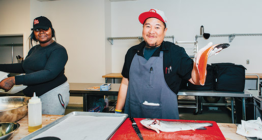 Chef Jefferson Sevilla prepares red trout as part of a meal order for corporate food broker Zesty.