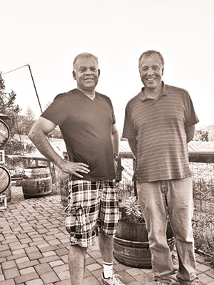 It's a family affair at Esterlina Vineyards, which is owned and operated by the four Sterling brothers and their father Murio (now retired). Pictured here are Stephen (left), who has an MBA and manages sales, and Chris, who manages the vineyards. Also involved are Craig, a lawyer, who manages the tasting room and offers legal counsel, and Eric, a physician, who is head winemaker. Murio, formerly a farmer, rancher, and home winemaker, inspires it all. Photo by Jillian Steinberger