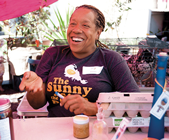 Urban farmer Wanda Stewart brought fresh eggs, bath salts, and medicated body balms to trade at the cash-free exchange behind the California Hotel.
