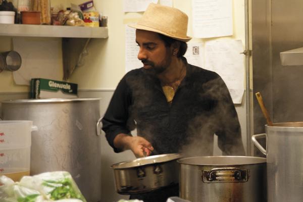 Saqib checks the pots in the Cosecha kitchen.