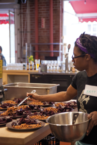 Britt Hart of Phat Beets Produce serves up a starter of roasted chickpeas and beets. Her organization is dedicated to closing the gap between small farmers of color and urban communities that would benefit from better availability of healthy and affordable, fresh produce.
