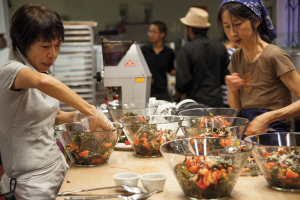 Machiko Saito and Misako Kashima prepared this radish and wakame salad for the People's Kitchen dinner in March.