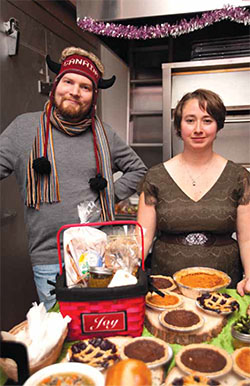 At an Oakland Kitchener pop-up market, Madeline Bills sells goodies like those she prepares at Oakland Kitchener for her catering business, Barbarian Gourmet (barbariangourmet.com). Her brother-in-law John Bettonville likes to help out at events.