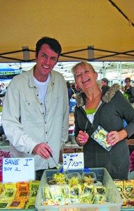 Brian Ogle and Helena Westlake sell Springhill Jersey Cheese at the Temescal Farmers' Market, including a selection of curds. (Photo by Helen Krayenhoff)