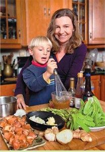 Jessica's son Tor, age 4, has a career ahead as a cooking show host, don't you think? Here, he helps his mom prepare this recipe with a demo on how to whisk the kuzu into the sauce. (Photo by Foster Wiley)