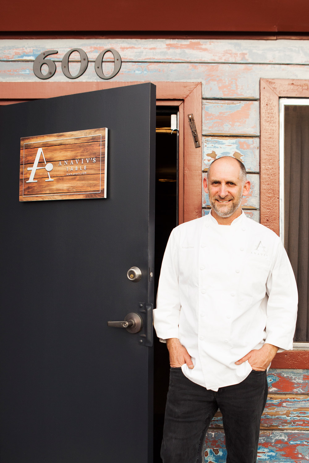 Arnon Oren at the entrance to his catering kitchen, now moonlighting as Anaviv's Table.