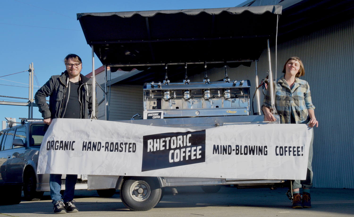 James and Ruthie with  their newly polished cart, all ready for Rhetoric Outside's first day of coffee service at the Temescal Farmers' Market, February 3, 2019.